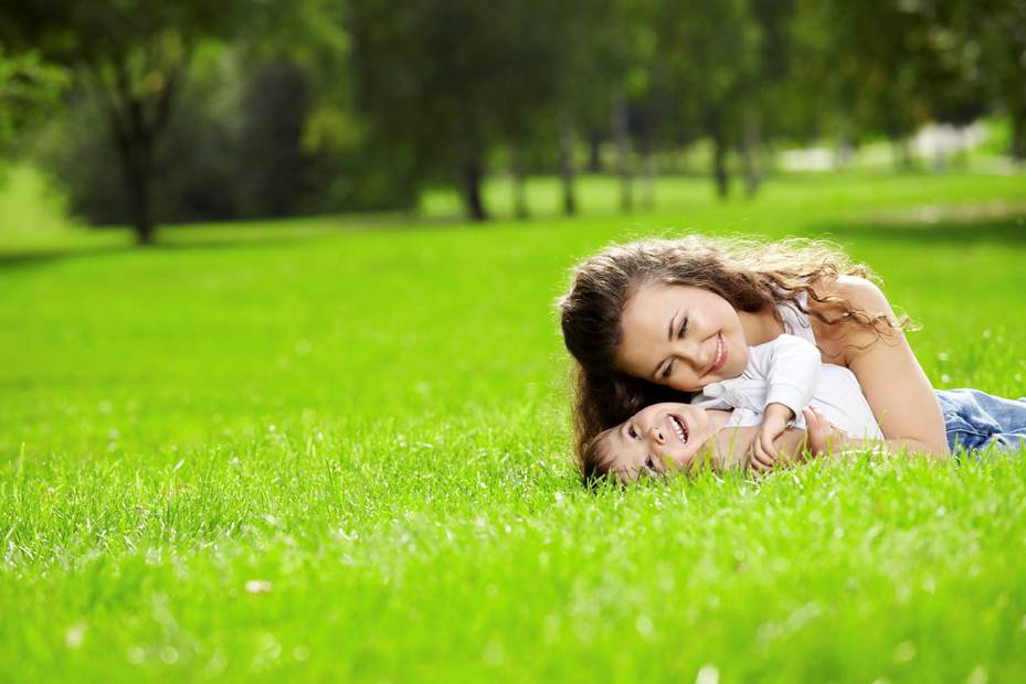 picture of mother and daughter on a lawn